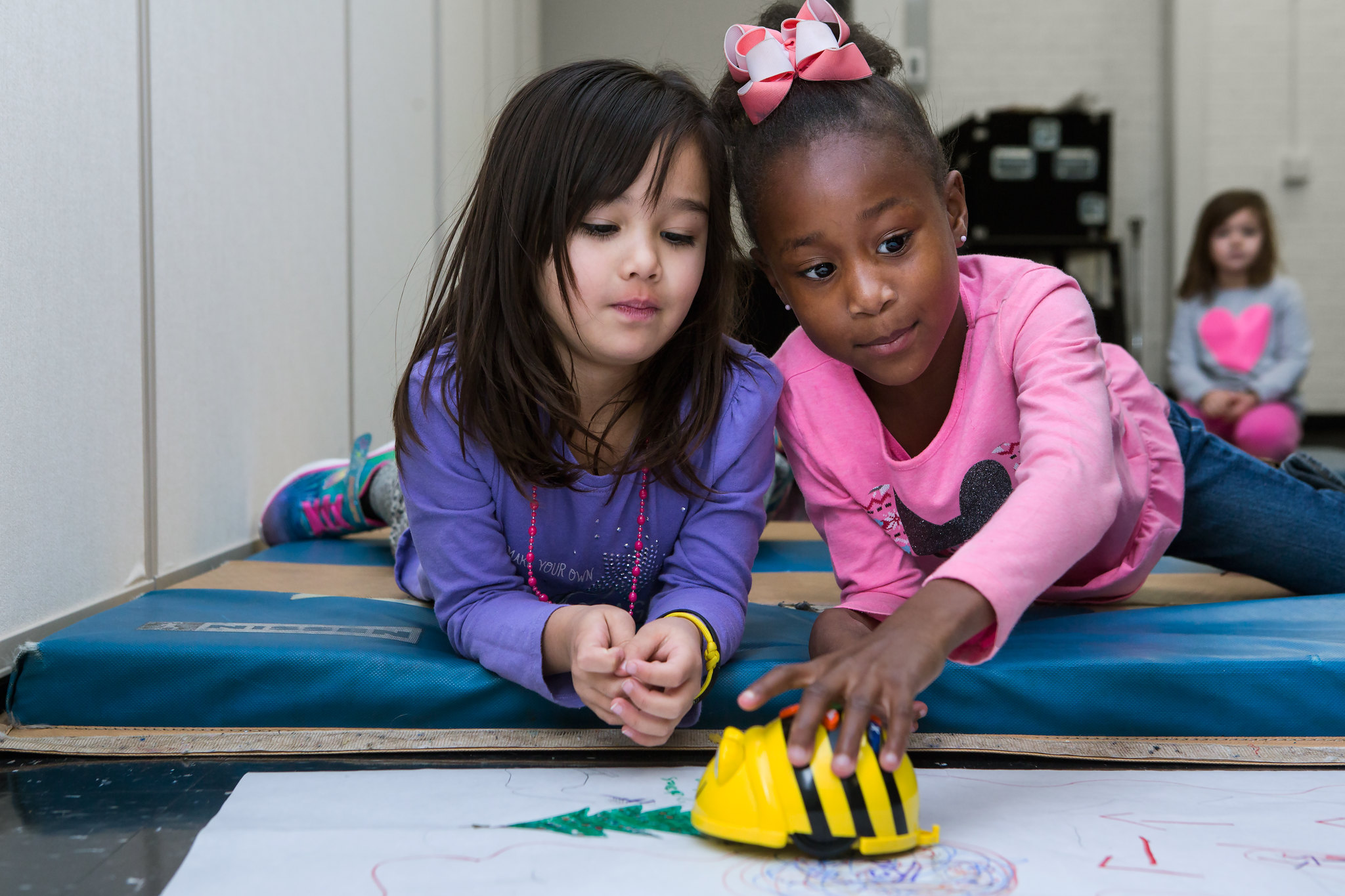 two students with a beebot